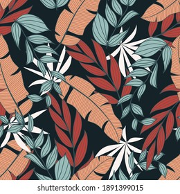 Original tropical seamless pattern with bright exotic plants and leaves on a dark blue background. Colorful stylish floral. Seamless exotic pattern with tropical plants.