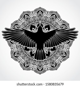 ornamental mandala background with silhouette crow