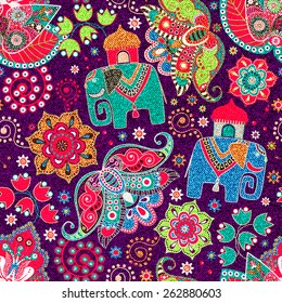 Ornamental seamless pattern, effect jeans texture. Floral wallpaper with decorative elephants, ornamental background. Cute indian pattern. For textile, fabric, wrapping paper, web
