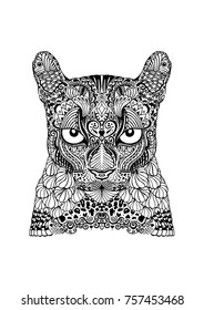 Ornamental, tattoo style mountain lion in black and white. Hand drawn vector doodle illustration, with leaves, scales, eyes and swirls. Decorative nature, big cat artwork.