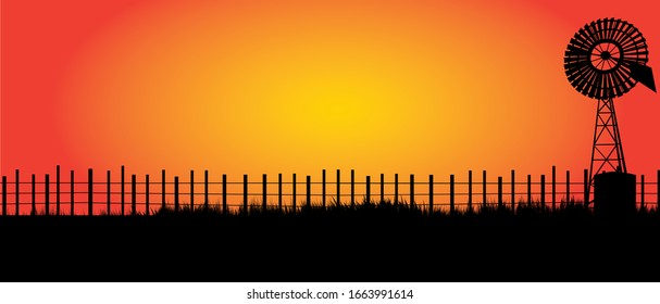 outback Australia with black fence and old windmill