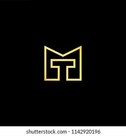 Outstanding professional elegant trendy awesome artistic black and gold color MT TM initial based Alphabet icon logo.