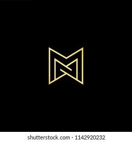 Outstanding professional elegant trendy awesome artistic black and gold color MM initial based Alphabet icon logo.