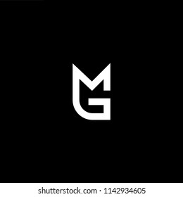 Outstanding professional elegant trendy awesome artistic black and white color MG GM initial based Alphabet icon logo.