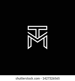 Outstanding professional elegant trendy awesome artistic black and white color MT TM initial based Alphabet icon logo.