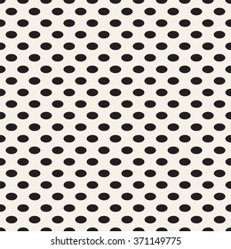 Oval vertical point. Black dots on white background. Vector seamless pattern.