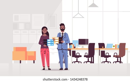 overworked man woman holding folder stack couple african american coworkers standing together paperwork hard working concept modern office interior flat full length horizontal