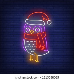 Owl in cap and scarf neon sign. Bird, owl, winter. Night bright advertisement. Vector illustration in neon style for banner, billboard