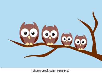 Owl family sitting on a tree branch