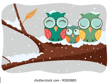 Owls family in a tree