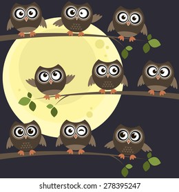 owls on branches with full moon behind them