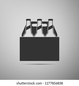 Pack of beer bottles icon isolated on grey background. Case crate beer box sign. Flat design. Vector Illustration