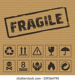 Packaging Symbols on Cardboard. Vector icons like: fragile, this side up, keep dry, recyclable etc