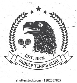 Paddle tennis badge, emblem or sign. Vector illustration. Concept for shirt, print, stamp or tee. Vintage typography design with paddle tennis racket and eagle silhouette.