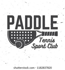 Paddle tennis sport club badge, emblem or sign. Vector illustration. Concept for shirt, print, stamp or tee. Vintage typography design with paddle tennis racket and paddle ball silhouette.