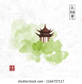Pagoda temple and green forest trees on rice paper background. Traditional oriental ink painting sumi-e, u-sin, go-hua. Contains hieroglyphs - eternity, freedom, happiness