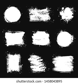 Paint brush stains, strokes, splatters and blots of different shapes for frame, banner, label, text box, clipping masks or other art design. Vector grunge textures isolated on black backgrounds.