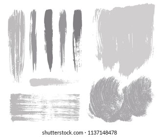 Paint lines grunge collection. Set of silver grungy hand drawn brush strokes isolated on white. Abstract ink texture, design elements, borders or frames. Brush strokes set backgrounds.
