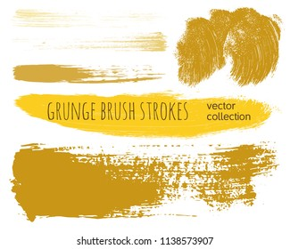 Paint lines grunge collection. Set of golden grungy hand drawn brush strokes isolated on white. Abstract ink texture, design elements, borders or frames. Brush strokes set backgrounds.