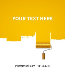 Painted yellow wall and paint roller