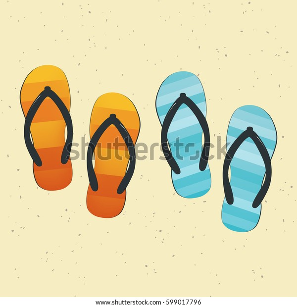 Pair of colorful flip-flops on sand