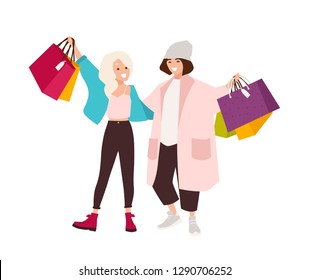Pair of happy teenage girls carrying shopping bags. Smiling young women holding their purchases. Pair of shopaholics. Funny cartoon characters isolated on white background. Flat vector illustration.