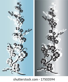 Pair of silver and black flowers with intricate ornaments and arabesques