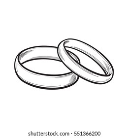 Pair of traditional golden wedding rings, sketch style illustration isolated on white background. Realistic hand drawing of rings for bride and groom, symbol of eternal love