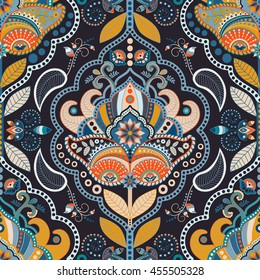 Paisley floral seamless pattern. Dark backdrop with indian decorative elements