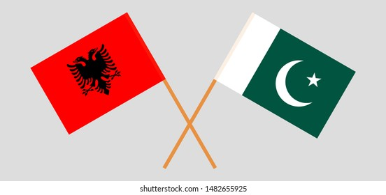 Pakistan and Albania. Crossed Pakistani and Albanian flags