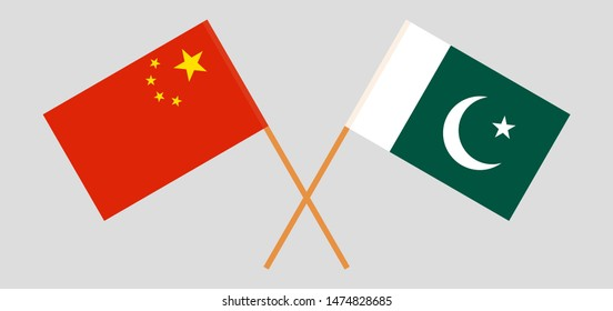 Pakistan and China. Crossed Pakistani and Chinese flags