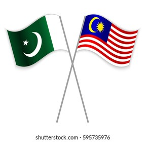 Pakistani and Malaysian crossed flags. Pakistan combined with Malaysia isolated on white. Language learning, international business or travel concept.