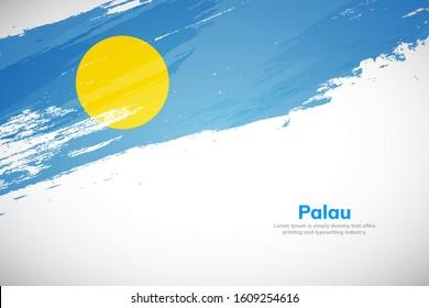 Palau flag made in brush stroke background. National day of Palau. Creative Palau national country flag icon. Abstract painted grunge style brush flag background.