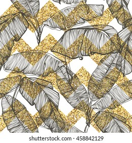 Palm leaves on golden glitter chevron background
