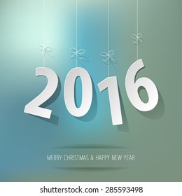 paper 2016 digits on blue bokeh background