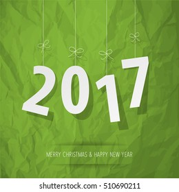 paper 2017 digits white on crumpled paper green background