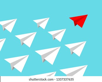 Paper airplane team with red leader conducting mission isolated on blue clear sky. Teamworking concept