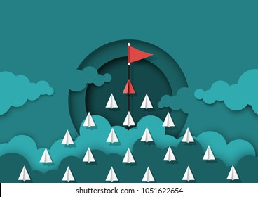 Paper airplanes teamwork flying to red flag target.Paper cut of business teamwork creative concept idea.Vector illustration