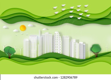 Paper art , cut and craft style of green eco urban city with airplane flying from building and nature cityscape background as Ecology design and environment conservation concept. Vector illustration