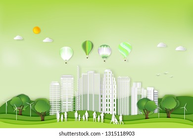 Paper art , cut and craft style of green eco urban city with people , hot air balloons and nature cityscape background as Ecology and environment conservation creative concept. Vector illustration