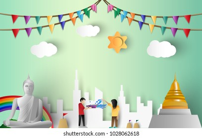 Paper Art illustration of Songkran Festival of Thailand with Cloud,Sun,Temple,Rainbow and city