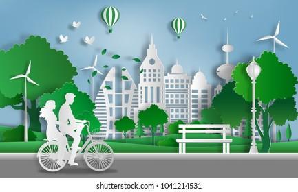 Paper art style of landscape with eco green city, Couple in love, happy couple riding together on bicycle, save the planet and energy concept, flat-style vector illustration.