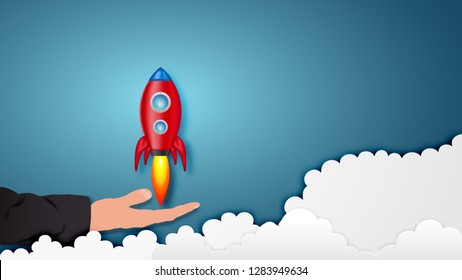 Paper art style of Rocket launch on hand as business start up and sucess concept. vector illustration.