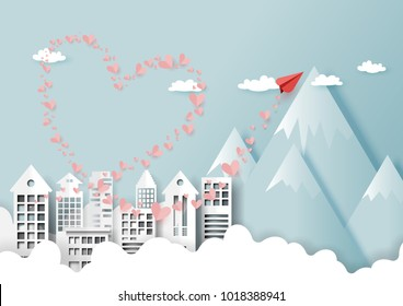 Paper art style of valentine's day greeting card and love concept.Red paper airplane flying on urban city landscape with mountains, clouds and blue sky.Vector illustration.