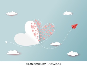Paper art style of valentine's day greeting card and love concept.Red airplanes flying couple of hearts shape on clouds and blue sky.Vector illustration.