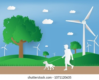 paper art of wind turbine on green landscape. concept green energy in nature
