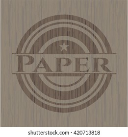 Paper badge with wooden background