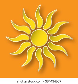 Paper bright shining sun on the orange sky.