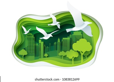 Paper carve to bird and park on green town shape, paper art concept and ecology idea, vector art and illustration.