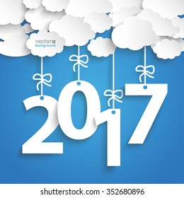 Paper clouds with text 2017 on the blue background. Eps 10 vector file.